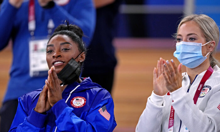 Simone Biles (L) and Mykalya Skinner (R) cheer during the Tokyo 2020 Olympic Summer Games at Ariake Gymnastics Centre on Aug. 2, 2021. (Danielle Parhizkaran/USA TODAY Sports via Reuters)