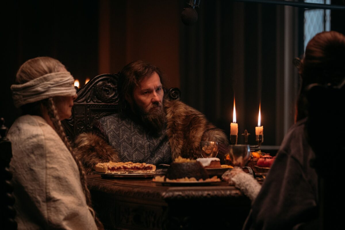 two women and one man in furs in The Green Knight