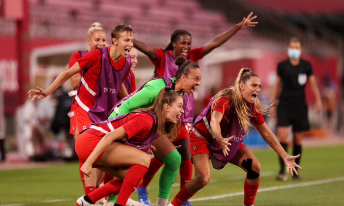 Players of Team Canada celebrate their side's first goal scored by Jessie Fleming #17 of Team Canada (not pictured) during the Women's Semi-Final match between USA and Canada on day ten of the Tokyo Olympic Games at Kashima Stadium on Aug. 2, 2021 in Kashima, Ibaraki, Japan. (Naomi Baker/Getty Images)