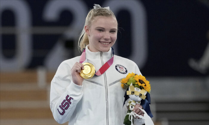 Jade Carey, of the United States, poses after winning the gold medal for the floor exercise during the artistic gymnastics women's apparatus final at the 2020 Summer Olympics in Tokyo, Japan, on Aug. 2, 2021. (Ashley Landis/AP Photo)