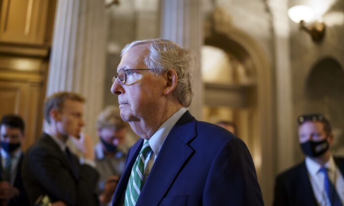 Senate Minority Leader Mitch McConnell (R-Ky.) walks past the chamber as the Senate advances to formally begin debate on a roughly $1 trillion infrastructure plan, at the Capitol in Washington, on July 30, 2021. (J. Scott Applewhite/AP Photo)