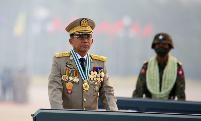 Burma's military ruler Min Aung Hlaing presides over an army parade on Armed Forces Day in Naypyitaw, Burma, on March 27, 2021. (Stringer/Reuters)