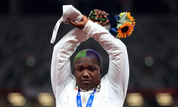 Raven Saunders of the United States gestures on the podium after winning silver in shot put at the Tokyo Olympics in Tokyo on Aug. 1, 2021. (Hannah Mckay/Reuters)
