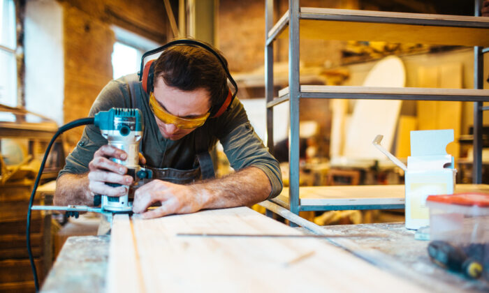 Circle-cutting is easy with a router and a shop-built trammel. (Pressmaster/Shutterstock)