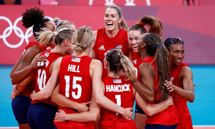 Andrea Drews of the United States celebrates with teammates, after defeating Team Italy during the Women's Preliminary—Pool B volleyball on day 10 of the Tokyo 2020 Olympic Games at Ariake Arena in Tokyo on Aug. 2, 2021. (Carlos Garcia Rawlins/Reuters)