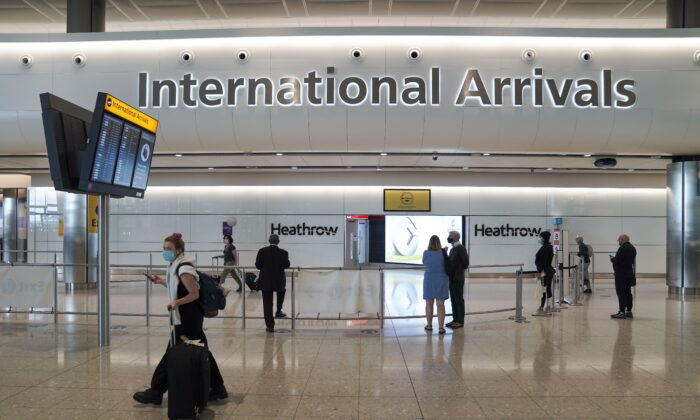 Passengers in the international arrivals hall at Terminal 2 of London Heathrow Airport, in London, UK, on July 29, 2021. (Steve Parsons/PA)