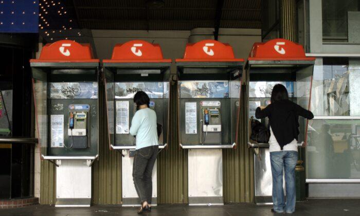 Telstra phone booths at Flinders Street station, Melbourne, Australia. (AAP Image/Simon Mossman)