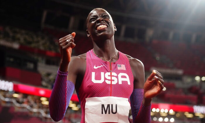 Athing Mu of the United States celebrates winning the gold medal in Tokyo on Aug. 3, 2021. (Aleksandra Szmigiel/Reuters)