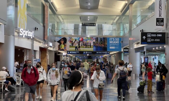 Passengers at Miami International Airport on Aug. 1, 2021, in Miami, Fla. (DANIEL SLIM/AFP via Getty Images)