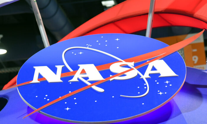 The NASA logo is displayed at the agency's booth at the Las Vegas Convention Center in Las Vegas, Nev., on Jan. 11, 2018. (Ethan Miller/Getty Images)
