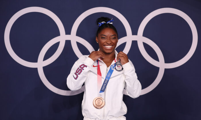 Simone Biles of Team USA poses with the bronze medal following the Women's Balance Beam Final on day eleven of the Tokyo 2020 Olympic Games at Ariake Gymnastics Centre on Aug. 3, 2021 in Tokyo, Japan. (Jamie Squire/Getty Images)