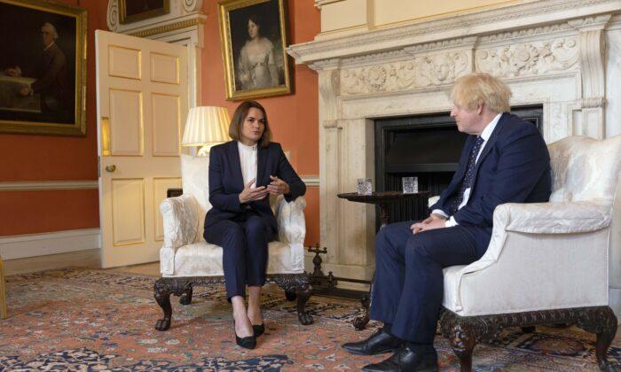 Belarusian human rights activist and politician Sviatlana Tsikhanouskaya meets Prime Minister Boris Johnson inside 10 Downing Street in London on Aug. 3, 2021. (Dan Kitwood/PA)