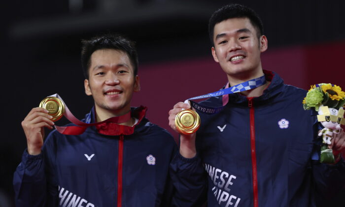 Gold medalists Lee Yang of Taiwan and Wang Chi-Lin of Taiwan pose with their men's doubles badminton gold medals at the medal ceremony at the Tokyo 2020 Olympics in Musashino Forest Sport Plaza in Tokyo, Japan, on July 31, 2021. (Leonhard Foeger/Reuters)