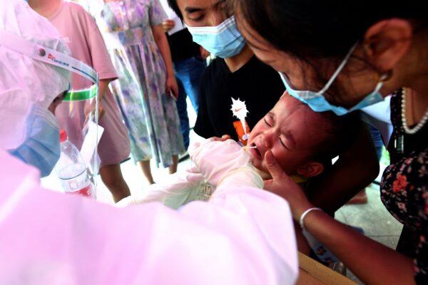 A medical worker takes swab samples