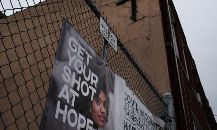 A sign asks people to get the COVID-19 vaccine in a Brooklyn neighborhood which is witnessing a rise in COVID-19 cases in New York City, on July 13, 2021. (Spencer Platt/Getty Images)