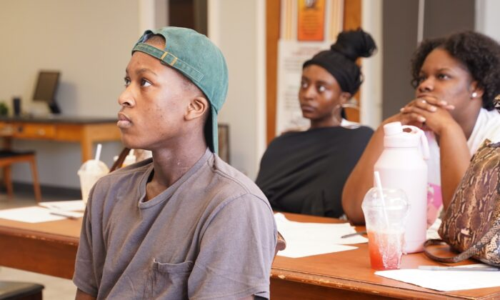 Christopher Bradley, 15, listens during a summer program session at Free Lunch Academy in the South Shore neighborhood on the South Side of Chicago on July 26, 2021. (Cara Ding/The Epoch Times)