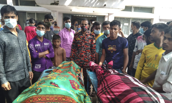 People gather around bodies of victims after lightning killed more than a dozen people in Shibganj in Chapainawabganj district, about 150 miles northwest of Dhaka, Bangladesh on Aug.4, 2021. (Md Jahangir Alom/AP Photo)