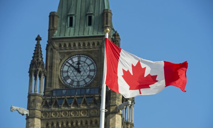 The Canadian flag flies near the Peace Tower on Parliament Hill in Ottawa in a file photo. (The Canadian Press/Sean Kilpatrick)