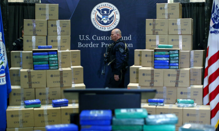 A police officer walks near cocaine seized from a cargo ship at a Philadelphia port during a news conference at the U.S. Custom House in Philadelphia, Pa., on June 21, 2019. (Eduardo Munoz Alvarez/Getty Images)