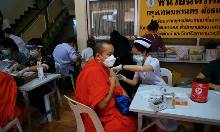 Buddhist monks receive a COVID-19 vaccine shot dose at Wat Si Sudaram Worawihan in Bangkok on July 30, 2021. The U.S. this week officially delivered 1.5 million vaccine doses to Thailand. The U.S. will be giving an additional million doses to further help the country fight the pandemic. (Lillian Suwanrumpha/AFP)