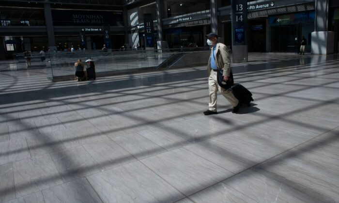 A man wears a mask as he arrives to Penn station in New York on Aug. 2, 2021. A rise in COVID cases has led to the reimposition of lockdowns and other containment measures. (Kena Betancur/AFP via Getty Images)