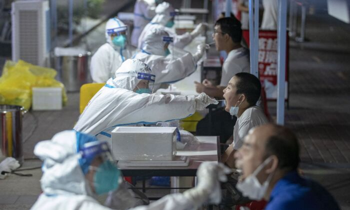 Residents are receiving nucleic acid tests for the coronavirus in Wuhan in China's central Hubei province on Aug. 3, 2021. (STR/AFP via Getty Images)