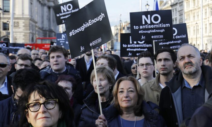 Members of the Jewish community hold a protest against Britain's opposition Labour party leader Jeremy Corbyn and antisemitism in the Labour party, outside the British Houses of Parliament in central London on March 26, 2018. (Tolga Akmen/AFP via Getty Images)