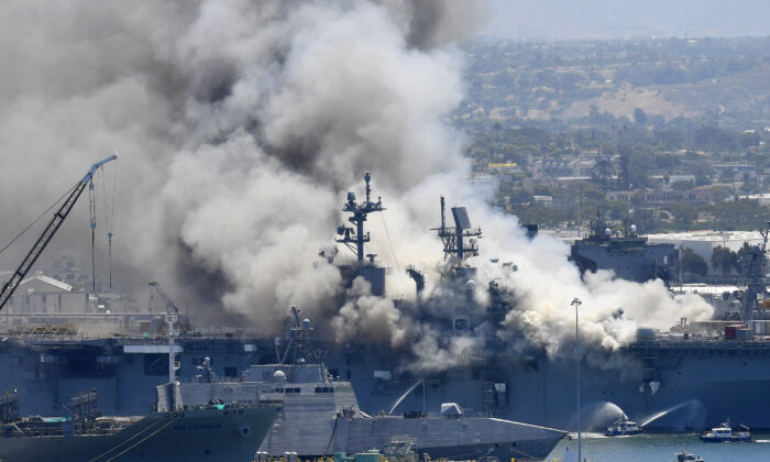 Smoke rises from the USS Bonhomme Richard in San Diego after an explosion and fire on board the ship at Naval Base San Diego in San Diego, Calif., on July 12, 2020. (Denis Poroy/AP Photo)
