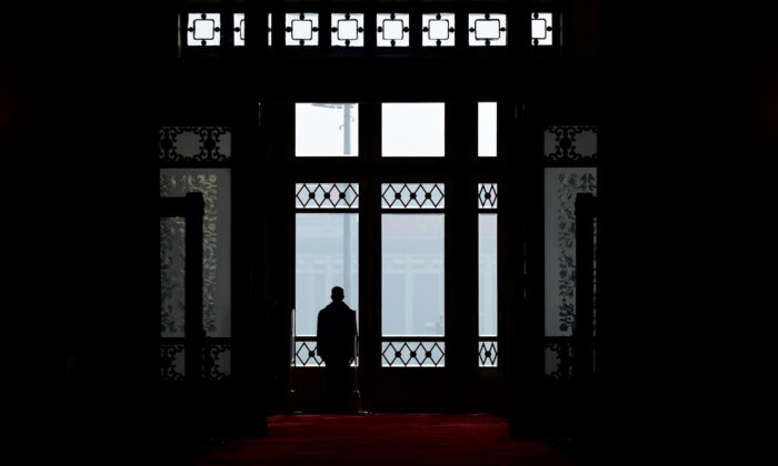 A security guard stands at the entrance of the Great Hall of the People during the fourth plenary session of the first session of the 13th National People's Congress in Beijing on March 13, 2018. (Wang Zhao/AFP via Getty Images)