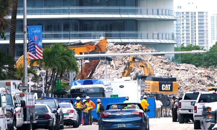 Crews work in the rubble of the Champlain Towers South building, as removal and recovery work continues at the site of the partially collapsed condo building in Surfside, Fla., on July 13, 2021. (Lynne Sladky/File/AP Photo)