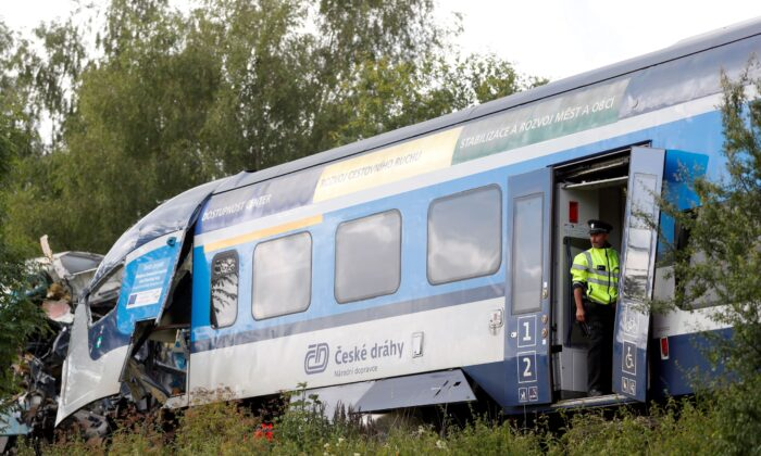 A police officer looks on from a carriage on a site of a train crash near the town of Domazlice, Czech Republic, on Aug. 4, 2021. (David W Cerny/Reuters)