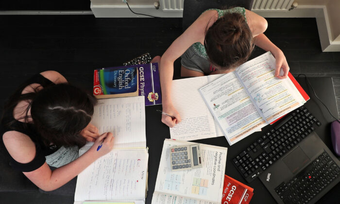 Children taking part in home schooling, studying mathmatics, english and sciences from their home in Liverpool, United Kingdom, on April 20, 2020. (Peter Byrne/PA)