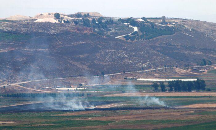 Smoke rises, seen from Marjayoun, near the border with Israel, Lebanon, on Aug. 4, 2021. (Karamallah Daher/Reuters)