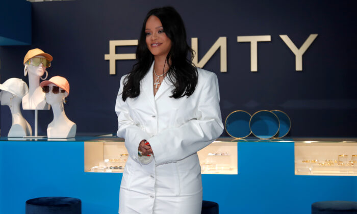 Pop star Rihanna poses in a pop-up store to present her first collection with LVMH for the new label, Fenty, in Paris, France, on May 22, 2019. (Charles Platiau/Reuters)
