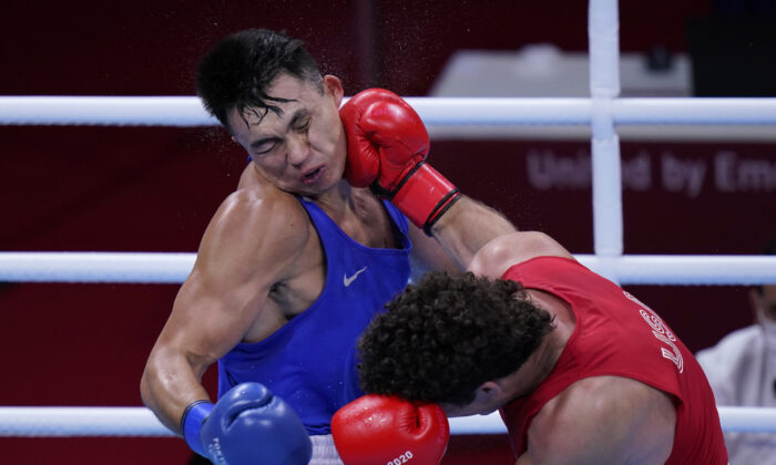 Richard Torrez Jr., of the United States, right, lands a shot to the face of Kamshybek Kunkabayev, of Kazakhstan, during their super heavy weight +91kg semifinal boxing match at the 2020 Summer Olympics, in Tokyo, Japan, on  Aug. 4, 2021. (Frank Franklin II/AP Photo)