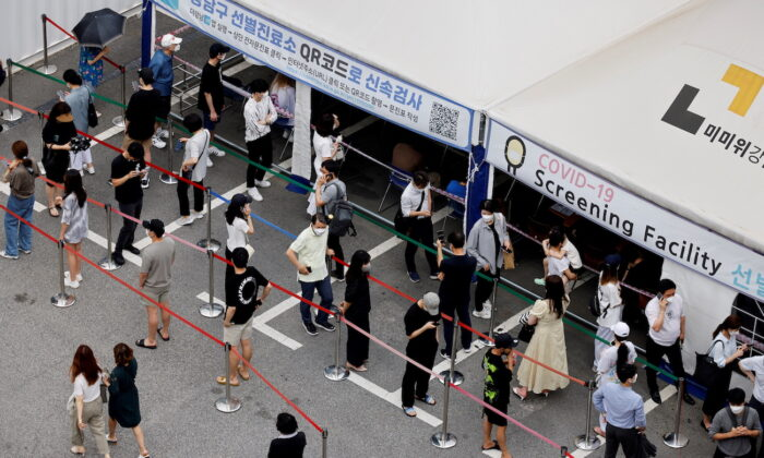 People wait in line for COVID-19 test at a testing site which is temporarily set up at a public health center in Seoul, South Korea, on July 9, 2021. (Heo Ran/Reuters)