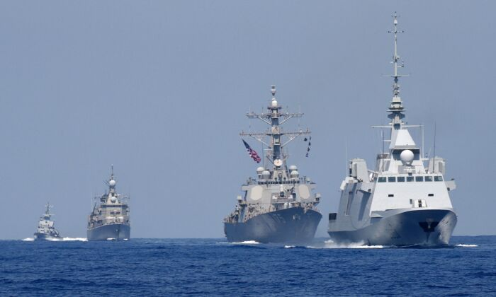 The French anti-submarine frigate FREMM Auvergne (R) and the US Navy USS Donald Cook class guided missile destroyer (2R) and the Greek HS Aigaion frigate (2L) during an exercise how simulate a humanitarian response to a powerful earthquake and significant movement of IDF vessels and foreign vessels in the Mediterranean sea on Aug. 7, 2019. (JACK GUEZ/AFP via Getty Images)