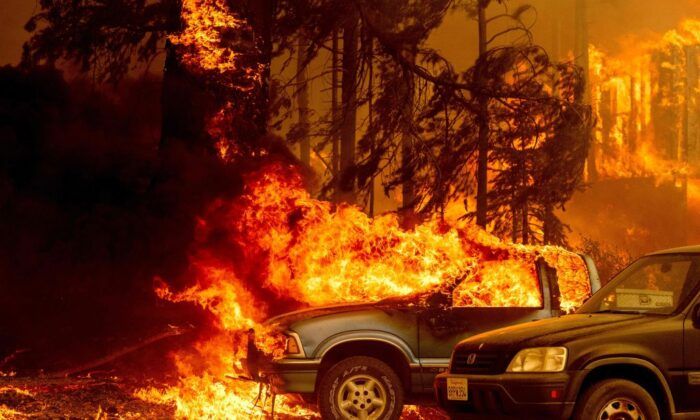 Vehicles and a home are engulfed in flames as the Dixie fire rages on in Greenville, Calif., on Aug. 5, 2021. (Josh Edelson/AFP via Getty Images)