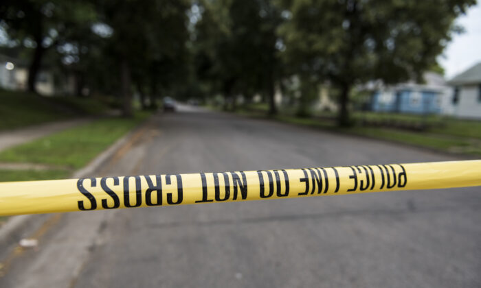 A piece of police tape is strung across North Camden Street in Minneapolis, Minn., on June 24, 2018. (Stephen Maturen/Getty Images)