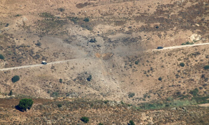 A view shows the damage in the aftermath of Israeli air strikes as seen from Marjayoun, near the border with Israel, Lebanon, on Aug. 5, 2021. (Karamallah Daher/Reuters)