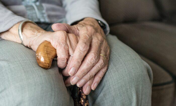 Stock photo of an elderly person holding a walking stick. (Sabine van Erp/Pixabay)