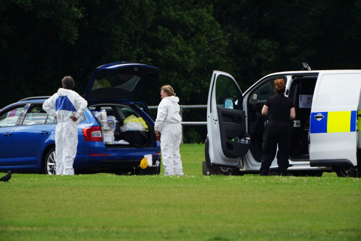 Police forensic officers at the scene in the Sarn area of Bridgend