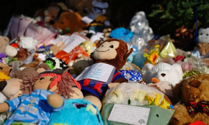 Tributes left at the scene in the Sarn area of Bridgend, south Wales, near to where 5-year-old Logan Mwangi was found dead in the Ogmore River, in Wales, Britain, on Aug. 3, 2021. (Ben Birchall/PA)