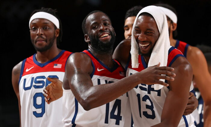 Draymond Green, center, and Bam Adebayo of the United States celebrate after beating Australia in Saitama, Japan, during the Tokyo Olympics on Aug. 5, 2021. (Brian Snyder/Reuters)