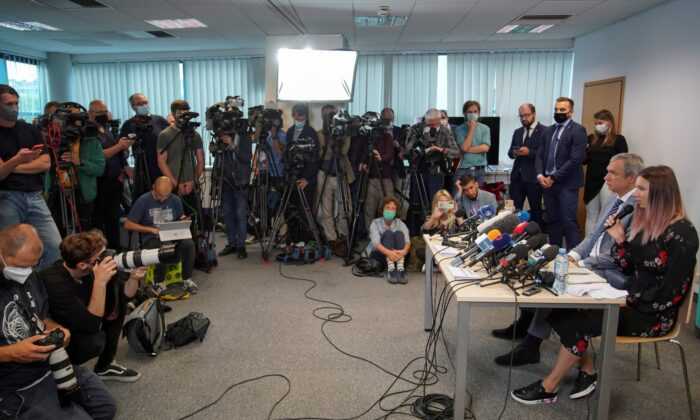 Belarusian sprinter Krystsina Tsimanouskaya, who left the Olympic Games in Tokyo and seeks asylum in Poland, and Belarusian opposition politician Pavel Latushka attend a news conference in Warsaw, Poland, on Aug. 5, 2021. (Darek Golik/Reuters)