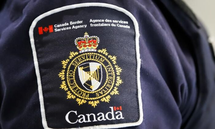 A Canada Border Services Agency (CBSA) patch is seen on an officer in Calgary, Alta.,on Aug. 1, 2019. The union representing 9,000 Canada Border Services Agency workers says some job actions began Friday as bargaining with the government continued. (The Canadian Press/Jeff Mcintosh)