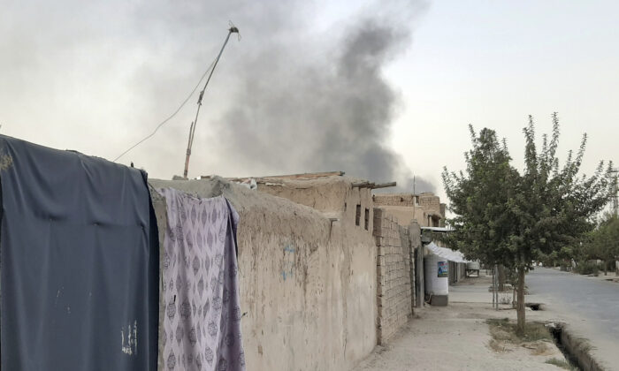 Smoke rises from the city of Lashkar Gah after an airstrike against the Taliban in Helmand province south of Kabul, Afghanistan on Aug. 6, 2021. (Abdul Khaliq/AP Photo)