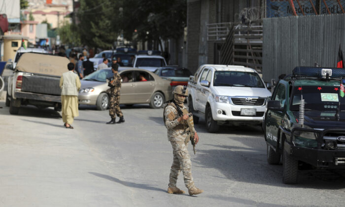 Afghan security personnel arrives at the area where the director of Afghanistan's Government Information Media Center Dawa Khan Menapal was shot dead in Kabul, Afghanistan on Aug. 6, 2021. (Rahmat Gul/AP Photo)