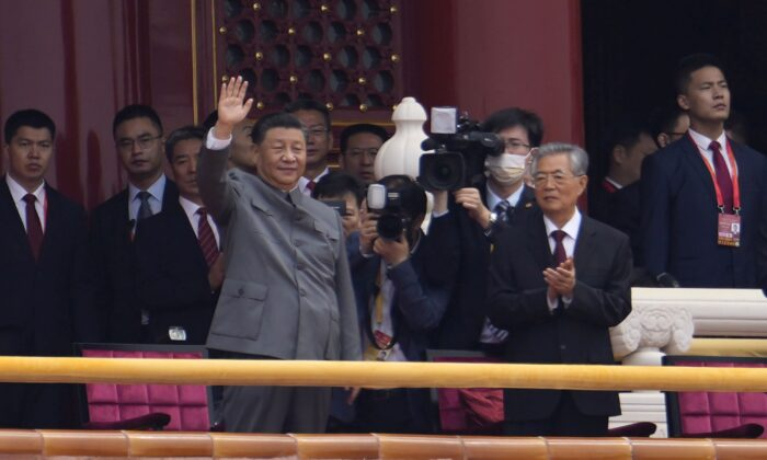 Chinese leader Xi Jinping waves during a ceremony to mark the 100th anniversary of the founding of the Chinese Communist Party at Tiananmen Gate in Beijing on July 1, 2021. (Ng Han Guan/AP Photo)