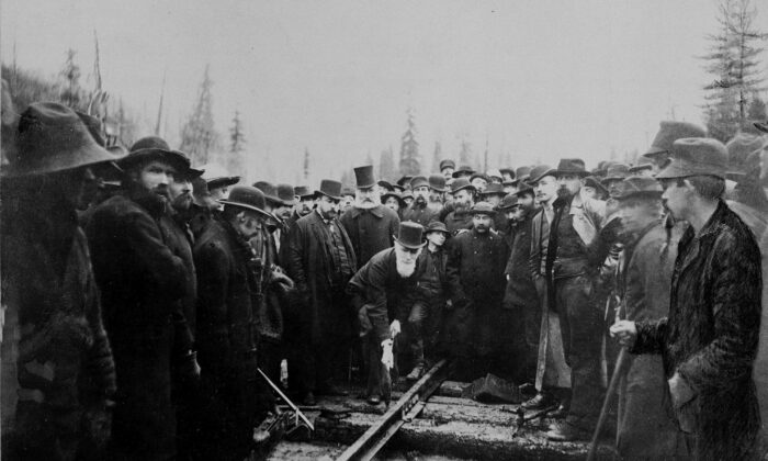 The Hon. Donald A. Smith drives home the last spike for the Canadian Pacific Railway in Eagle Pass, B.C., on Nov. 7, 1885. (The Canadian Press/National Archives of Canada)